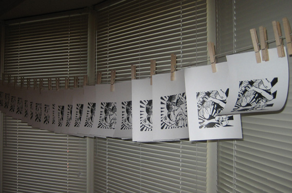 woodblock prints hanging to dry